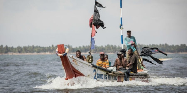 Fishermen at sea in Ghana