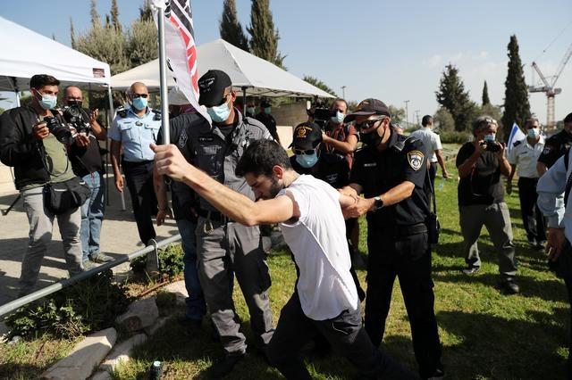 Police arresting a protestor