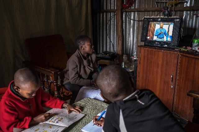 Children having TV education