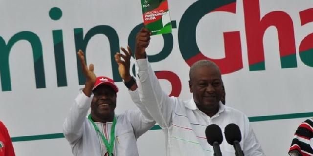 Mahama holding the Green Book