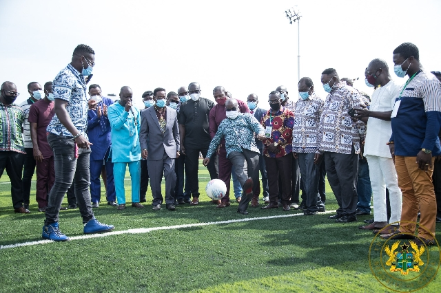President Akufo-Addo kickin a ball to commission the AstroTurf facility