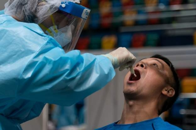 Hong Kong doctor testing patient