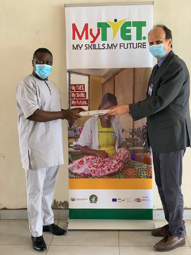 Dr Fred Asamoah and Mr Detlev Jahn Axel holding the MoU document