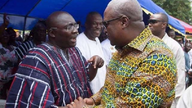 Vice-President Mahamudu Bawumia (L) and former President John Mahama in a chat (R)
