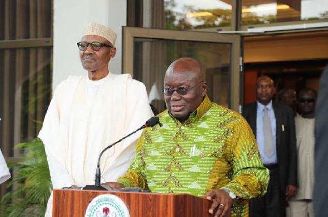 Standing behind Akufo-Addo is Buhari