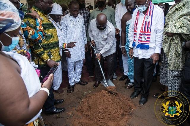 President Nana Akufo-Addo with a shovel