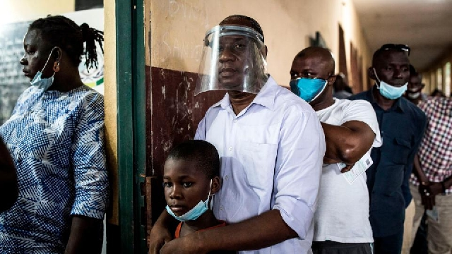 Citizens line up to vote in Conakry, Guinea.
