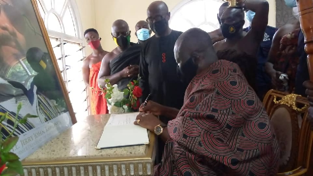 The Asantehene took the opportunity to sign the book of condolence opened in honour of the late President